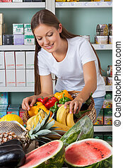 Woman Shopping Fruits And Vegetables In Supermarket