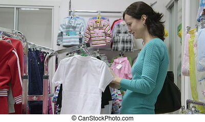 Woman shopping in clothes shop