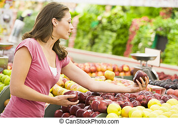 Woman shopping in produce department