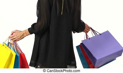 Woman shopping in sale period. White. Slow motion