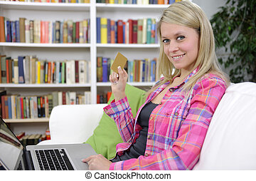 woman shopping online with laptop