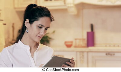 Woman shopping online with tablet. through glass