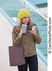 woman shopping with coffee and phone