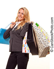 Woman shopping with many shopping bags has joy