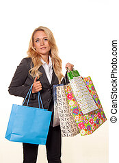 Woman shopping with many shopping bags
