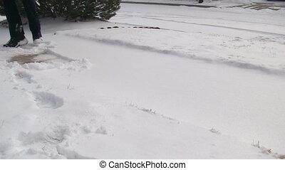 Woman shoveling snow