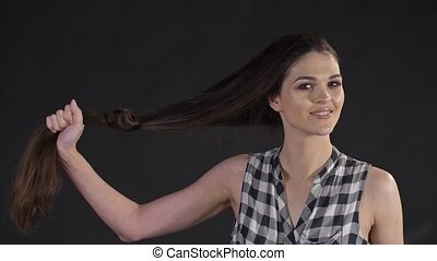 Woman show healthy hair - Woman demonstrate long strong hair