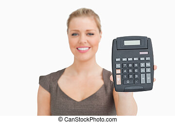 Woman showing a calculator in her hand
