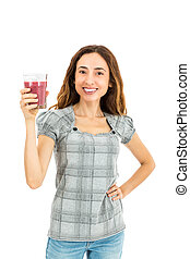 Woman showing a glass of smoothie