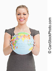 Woman showing a globe