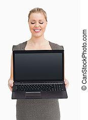 Woman showing a laptop screen