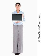 Woman showing a laptop
