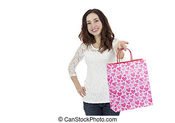 Woman showing a paper gift bag