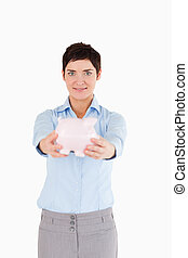 Woman showing a piggy bank