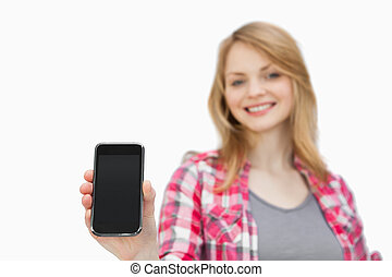 Woman showing a smartphone
