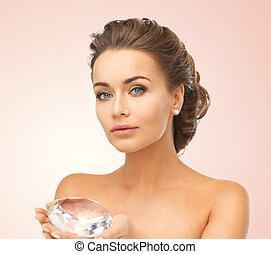 woman showing big diamond - close-up of beautiful woman with...
