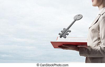 Woman showing big metal key