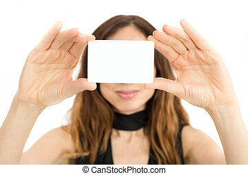 Woman showing copy space on business card