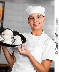 Woman Showing Dough Balls In Baking Tray