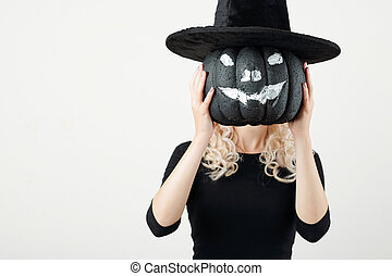 Woman showing Halloween party decoration