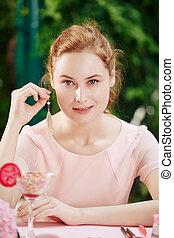 Woman showing her earrings