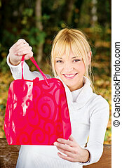 woman showing her shopping bag - Happy woman showing her...