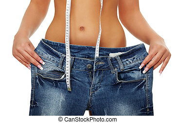 Young woman showing how much weight she lost. Isolated on white