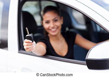 woman showing new car key