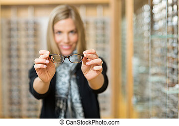 Woman Showing New Reading Glasses