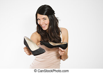 Woman showing off classic black court shoes - Smiling...