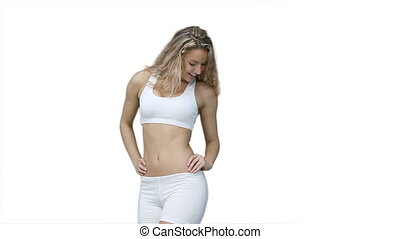 Woman showing off her figure against a white background