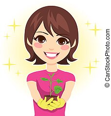 Woman Showing Plant Growth - Cute woman happy showing green...