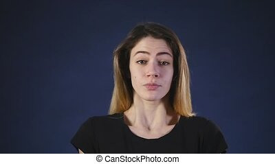 woman showing she does not know black background slow motion