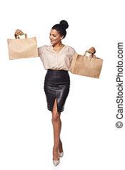 Woman showing shopping bag