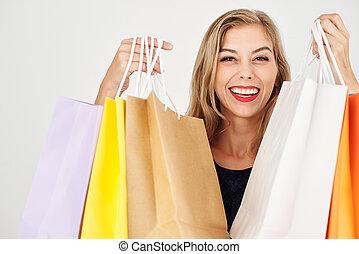 Woman showing shopping bags