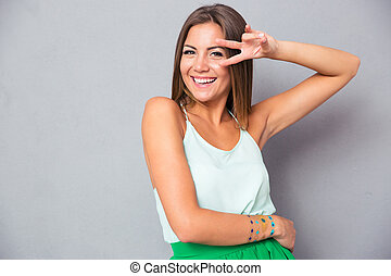Woman showing two fingers - Laughing woman showing two ...