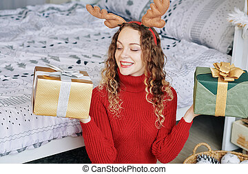 Woman showing two presents
