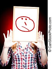 Woman showing unsure emoticon in front of face