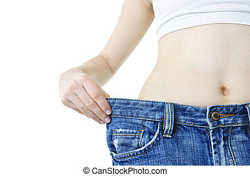 Woman showing weight loss - Fit young woman in loose jeans...