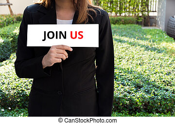 Woman showing white sign with join us word