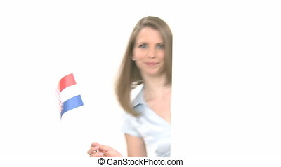 Woman shows Flag with Copyspace