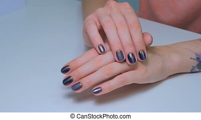 Woman shows her new manicure. Purple nail
