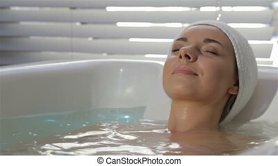 Woman shows her thumb up at the therapeutic bath