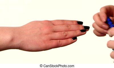 Woman shows popular bracelet shamballa on hand, white...