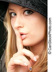 woman shush sign - Beautiful blonde woman face showing shush...