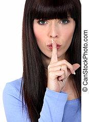 Woman shushing
