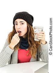 Woman sick and taking medicine