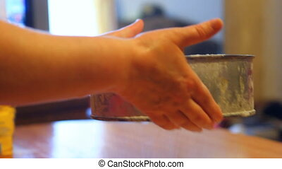 woman sifts the flour through a sieve