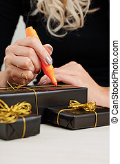Woman signing Halloween presents