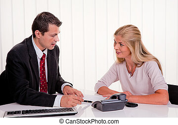 Woman signs a contract in an office - Young woman signs a ...